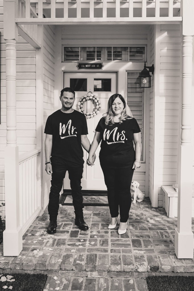 bride and groom smile before intimate wedding ceremony at home with Taylor Made Photography