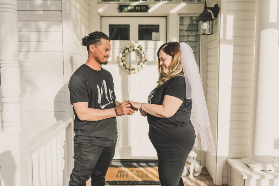 newlyweds exchange rings on front steps of their home with Taylor Made Photography