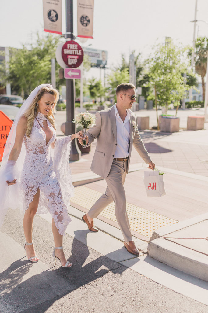 groom and bride walk Las Vegas streets after eloping photographed by Taylor Made Photography