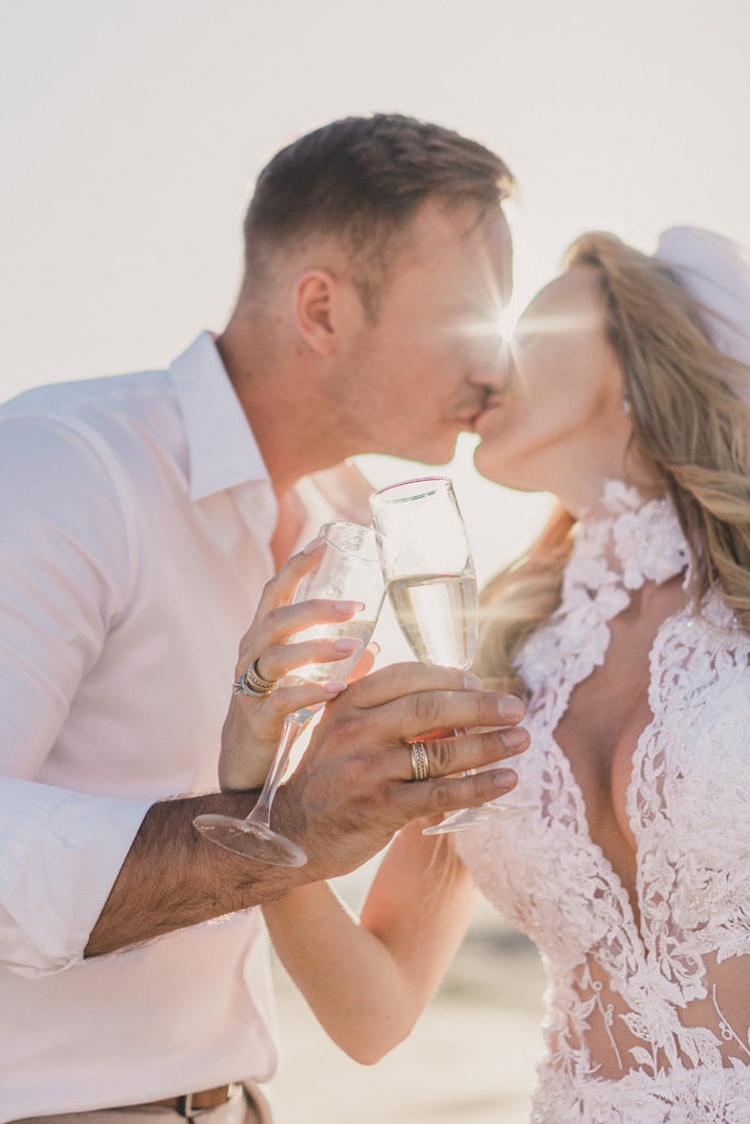 couple cheers elopement in Las Vegas photographed by Taylor Made Photography