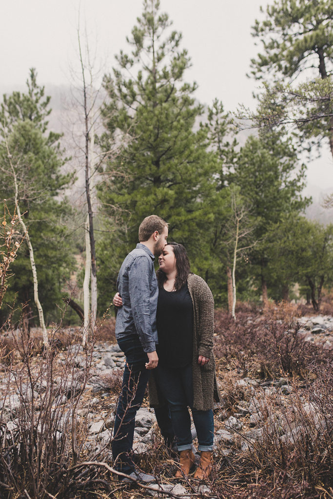 Taylor Made Photography photographs couple during rainy engagement session at Mt. Charleston