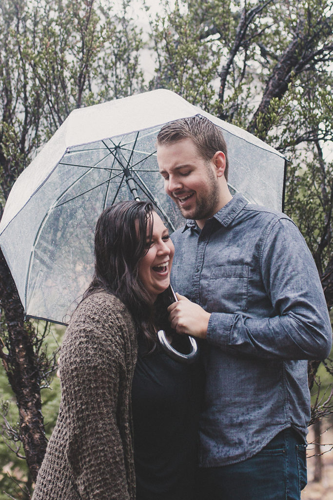 couple laughs through rainy engagement portraits with Taylor Made Photography