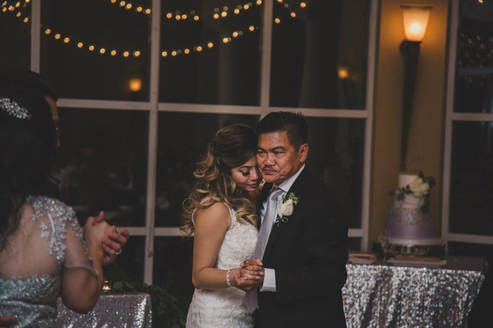 bride and father dance during wedding reception at Canyon Gate Golf Club