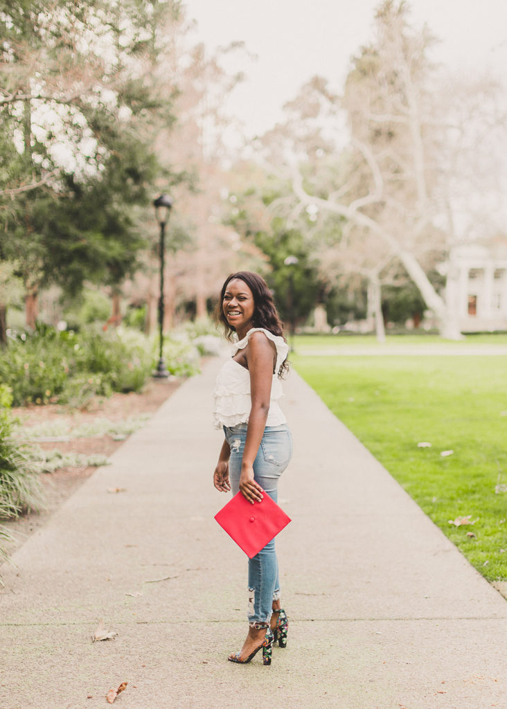 college grad celebrates graduation with Taylor Made Photography