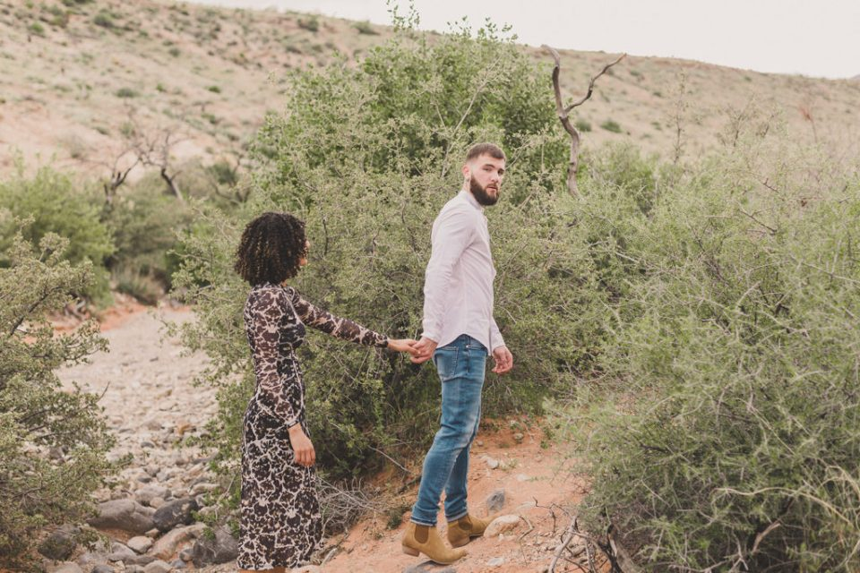 engagement session along green field of Red Rock Canyon with Taylor Made Photography