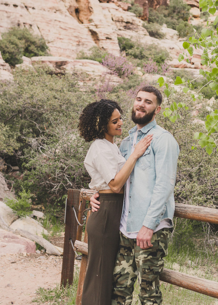 couple laughs during engagement session with Taylor Made Photography