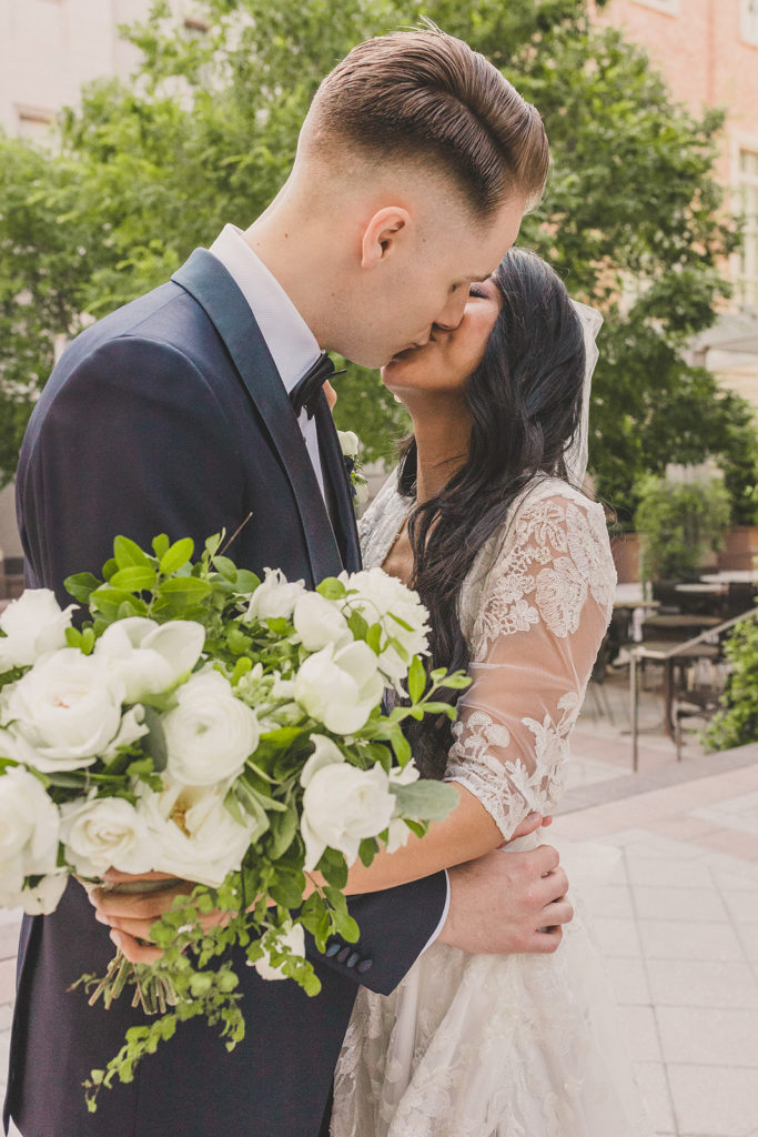 groom kisses his bride before Las Vegas wedding day with Taylor Made Photography