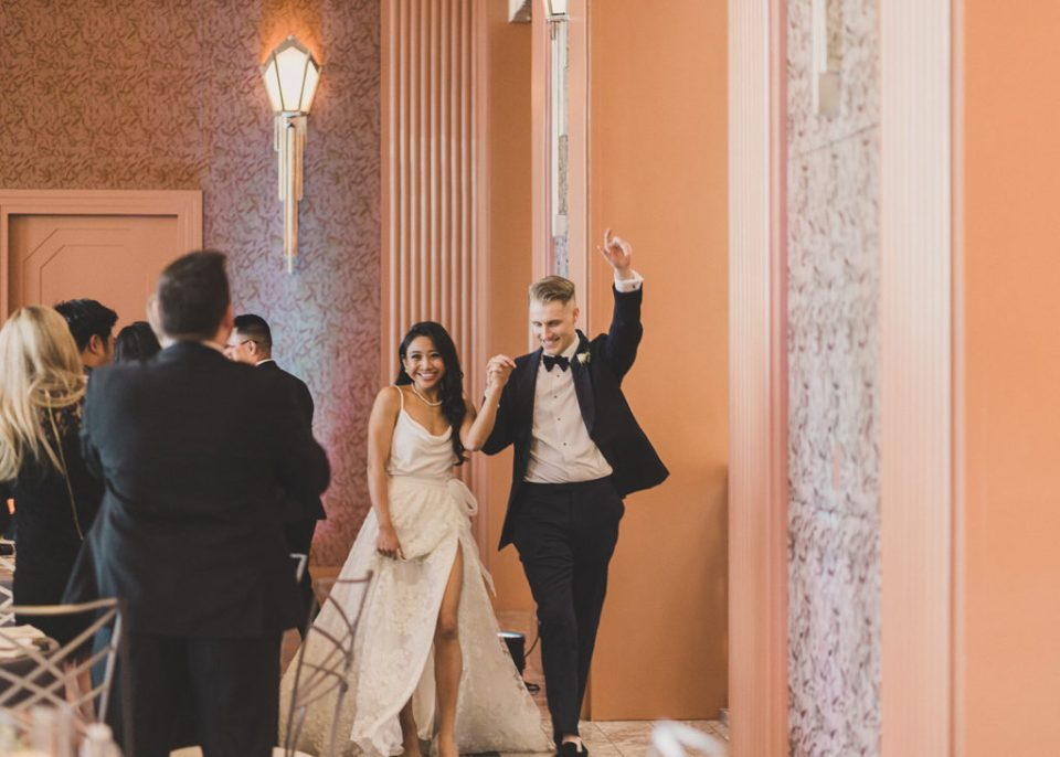 Taylor Made Photography captures bride and groom entering wedding reception