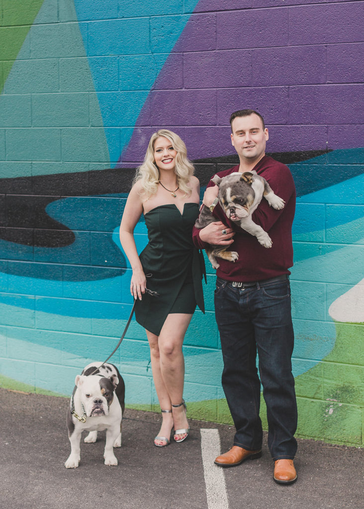 Family portraits with dogs by murals in Las Vegas photographed by Taylor Made Photography