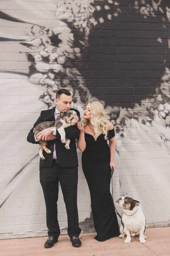 family portraits in Las Vegas with murals and dogs by Taylor Made Photography