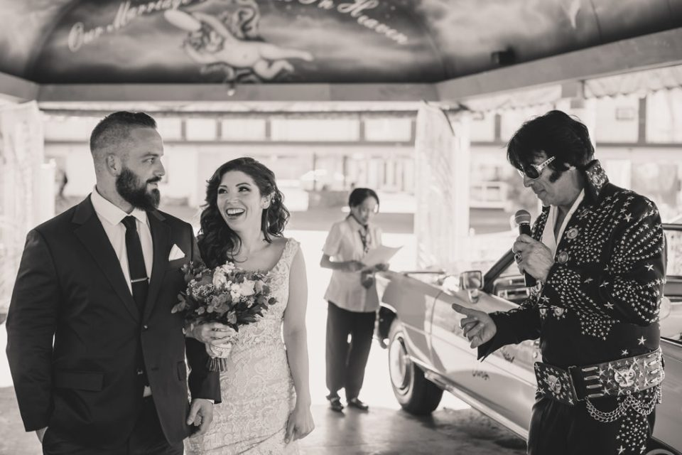 bride and groom smile during wedding ceremony in Las Vegas photographed by Taylor Made Photography