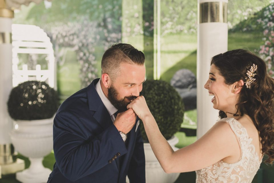 groom kisses bride's hand in Las Vegas with Taylor Made Photography