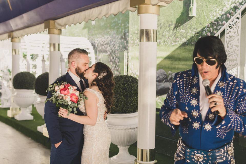 Taylor Made Photography photographs newlyweds kissing while Elvis sings