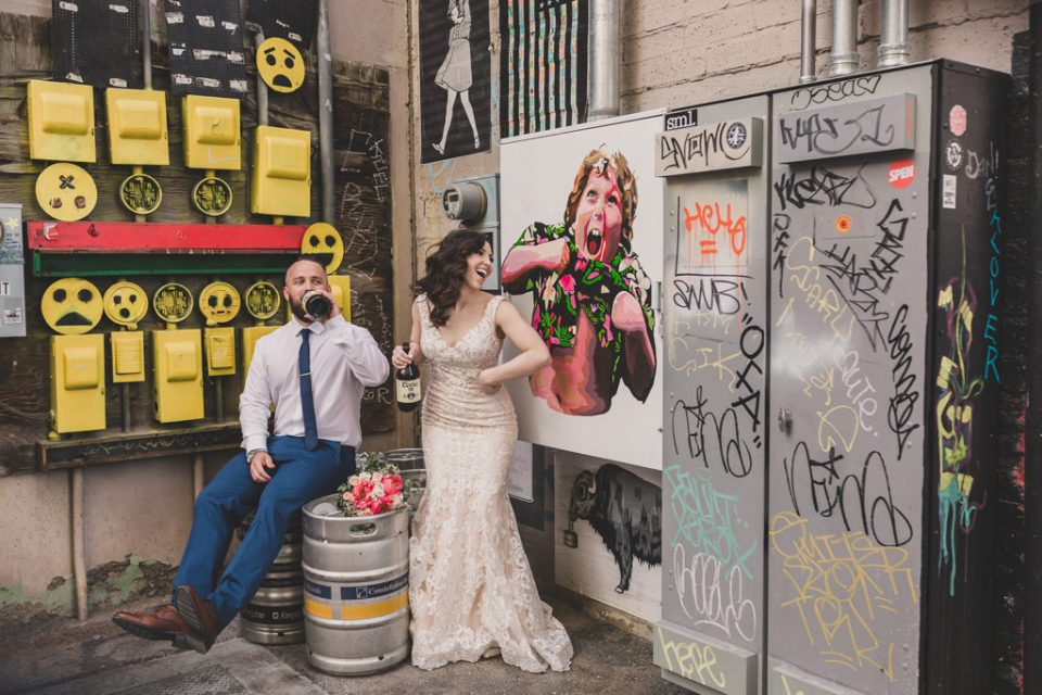elopement portraits by murals on Fremont Street photographed by Taylor Made Photography