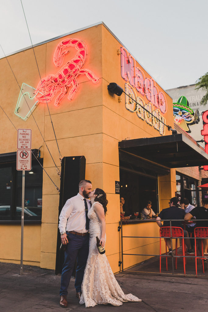 newlyweds pose by Las Vegas restaurant photographed by Taylor Made Photography