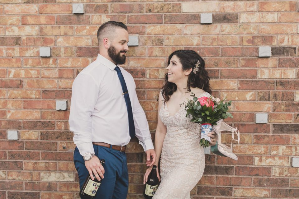 bride and groom with 40oz beers smile photographed by Taylor Made Photography