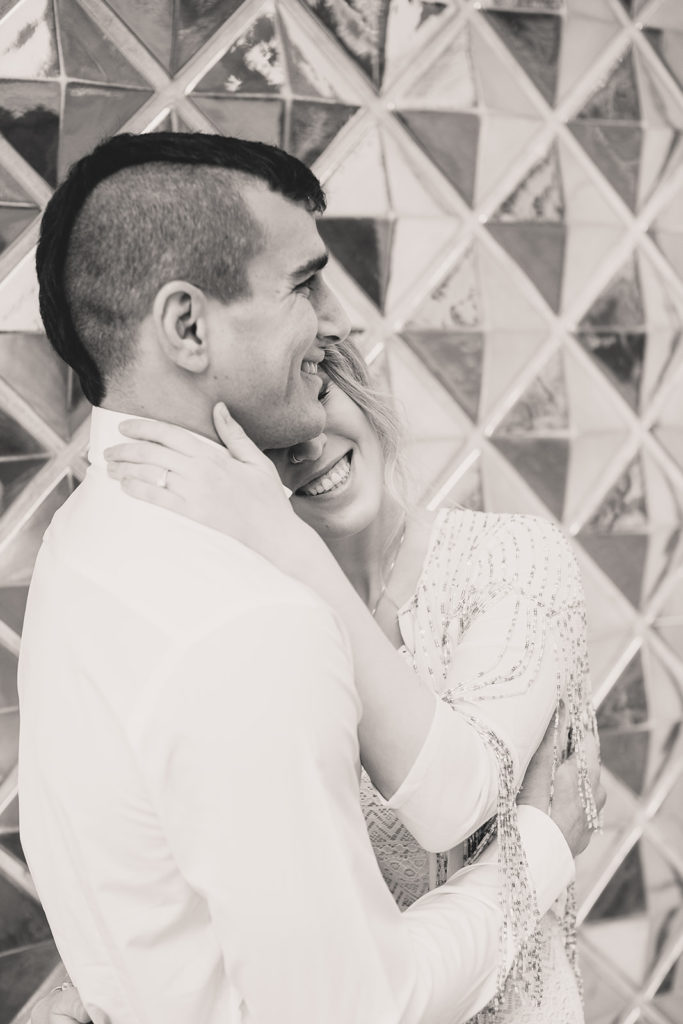 bride and groom laugh during engagement portraits with Taylor Made Photography