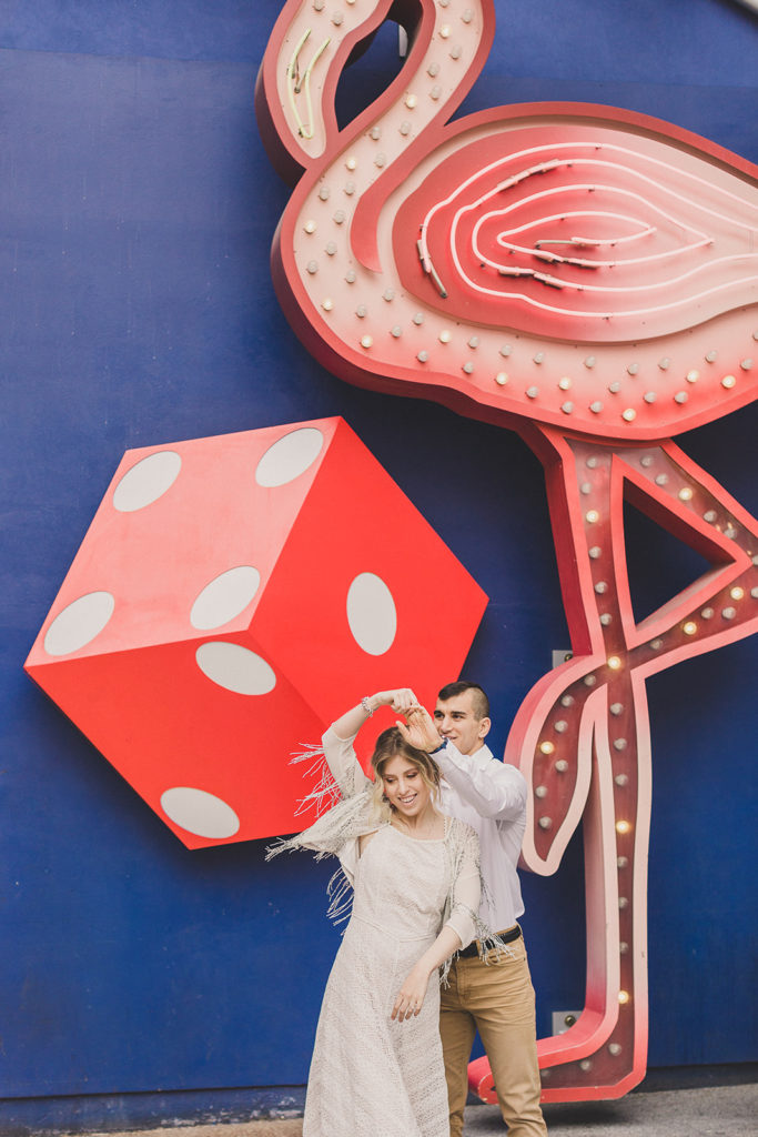 couple dances in front of mural in Las Vegas with Taylor Made Photography