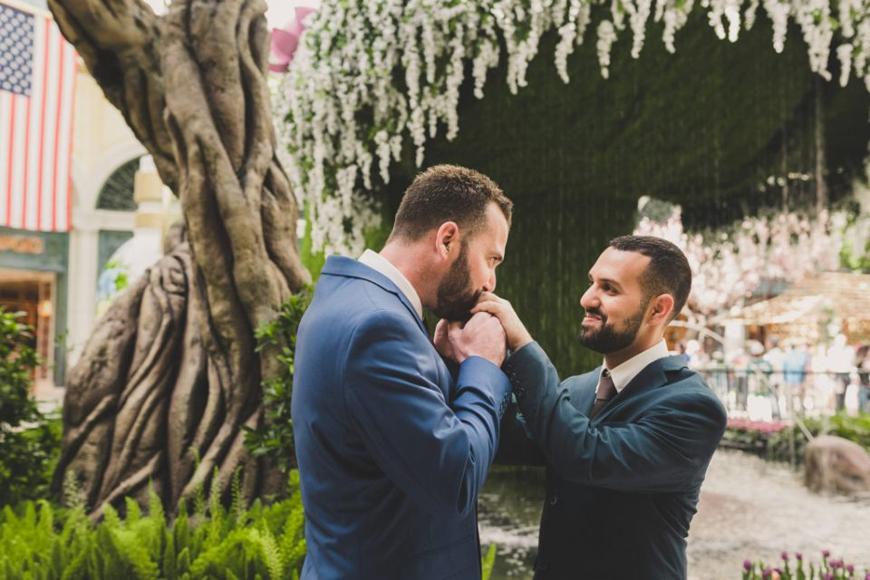 Taylor Made Photography captures groom kissing groom's ring in Las Vegas