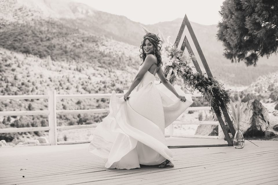 bride twirls in wedding dress photographed by Taylor Made Photography