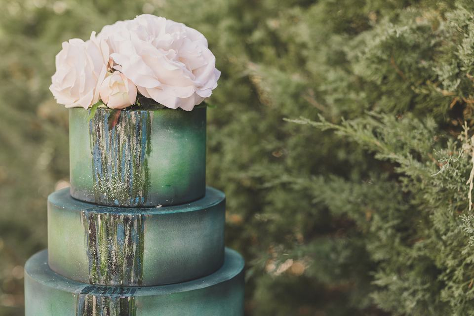 green wedding cake by Rolling in Dough Bakery