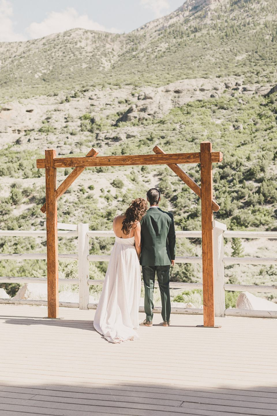 bride and groom admire view from Mt Charleston photographed by Taylor Made Photography