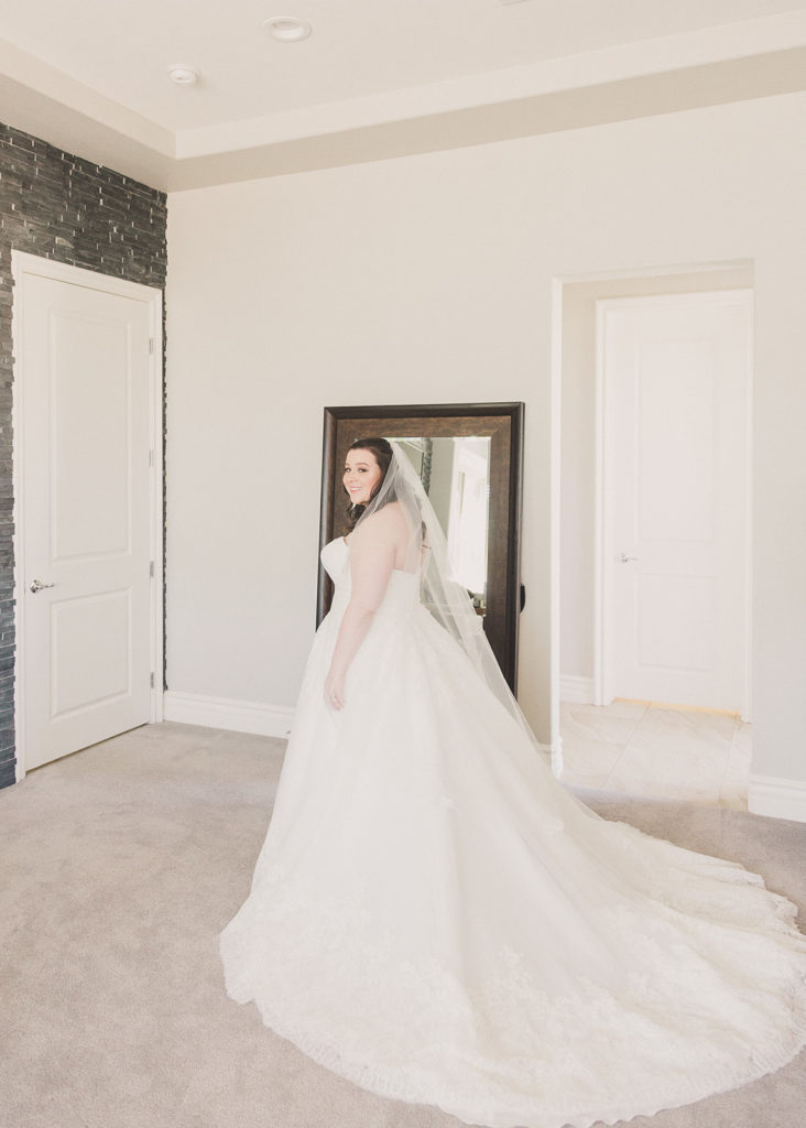 bride poses for Taylor Made Photography