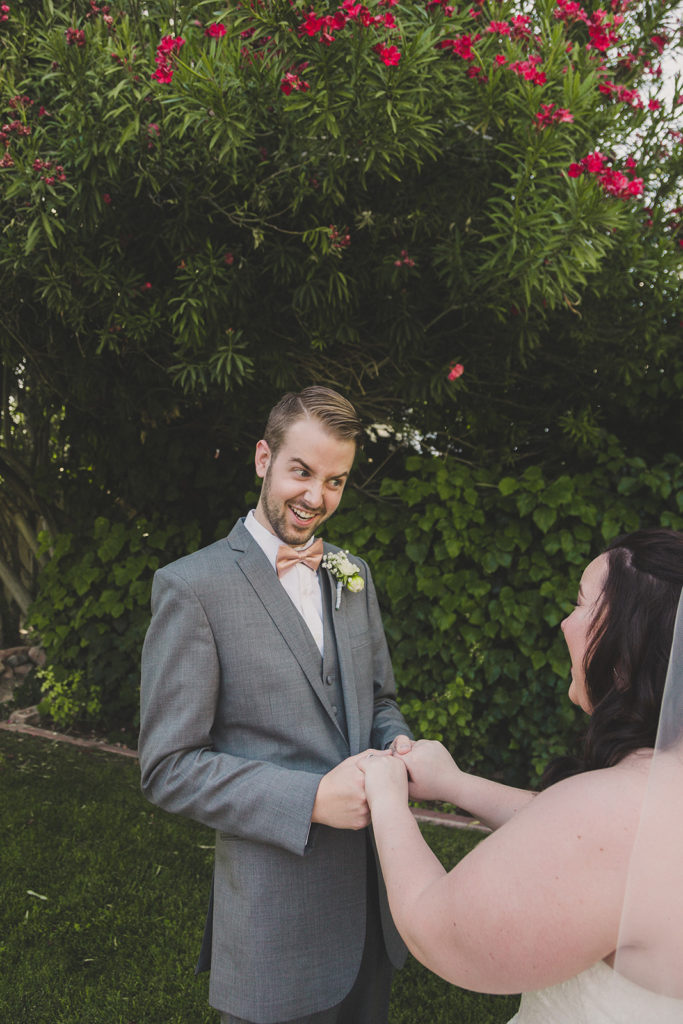 groom laughs with bride during first look at the Grove photographed by Taylor Made Photography