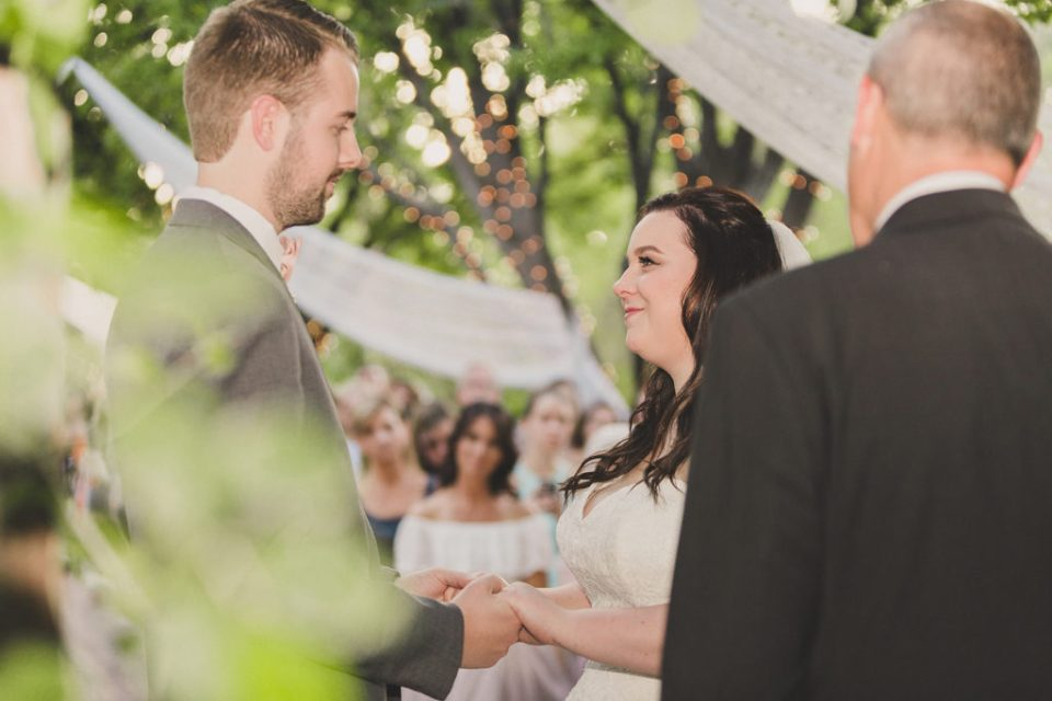 outdoor wedding ceremony exchanging vows photographed by Taylor Made Photography