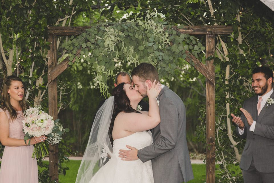 first kiss at the Grove wedding ceremony photographed by Taylor Made Photography