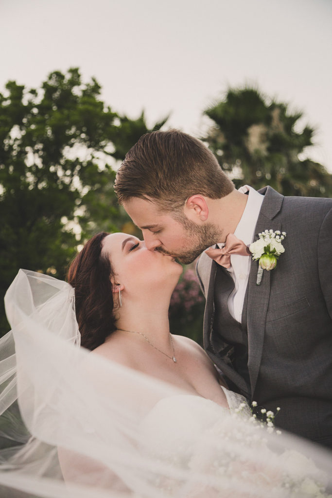 first kiss as husband and wife photographed by Taylor Made Photography