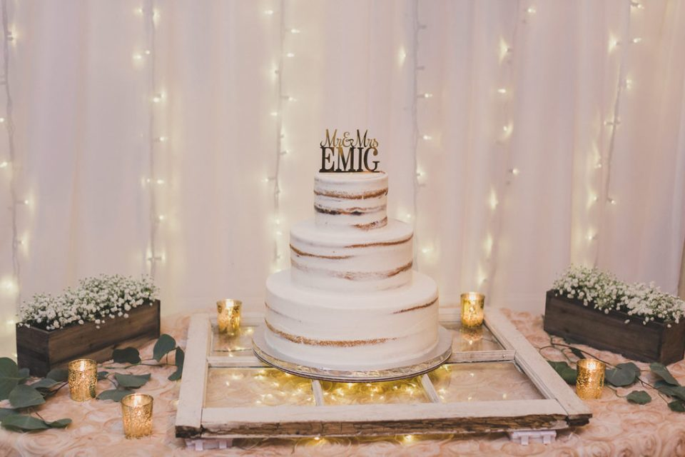 tiered wedding cake with gold details photographed by  Taylor Made Photography