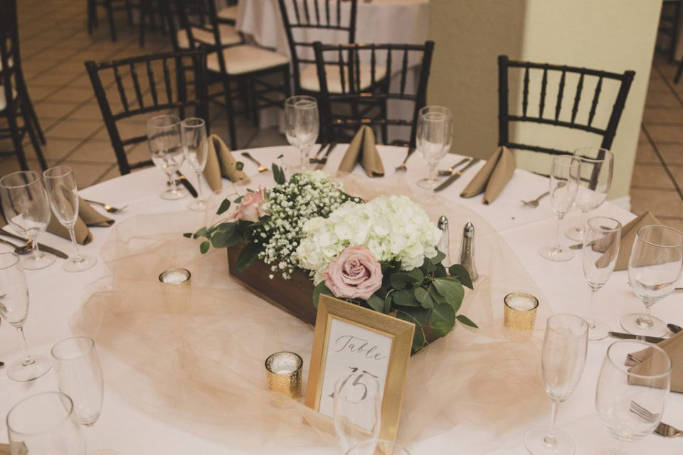 gold and white decor for reception tables in Las Vegas photographed by  Taylor Made Photography