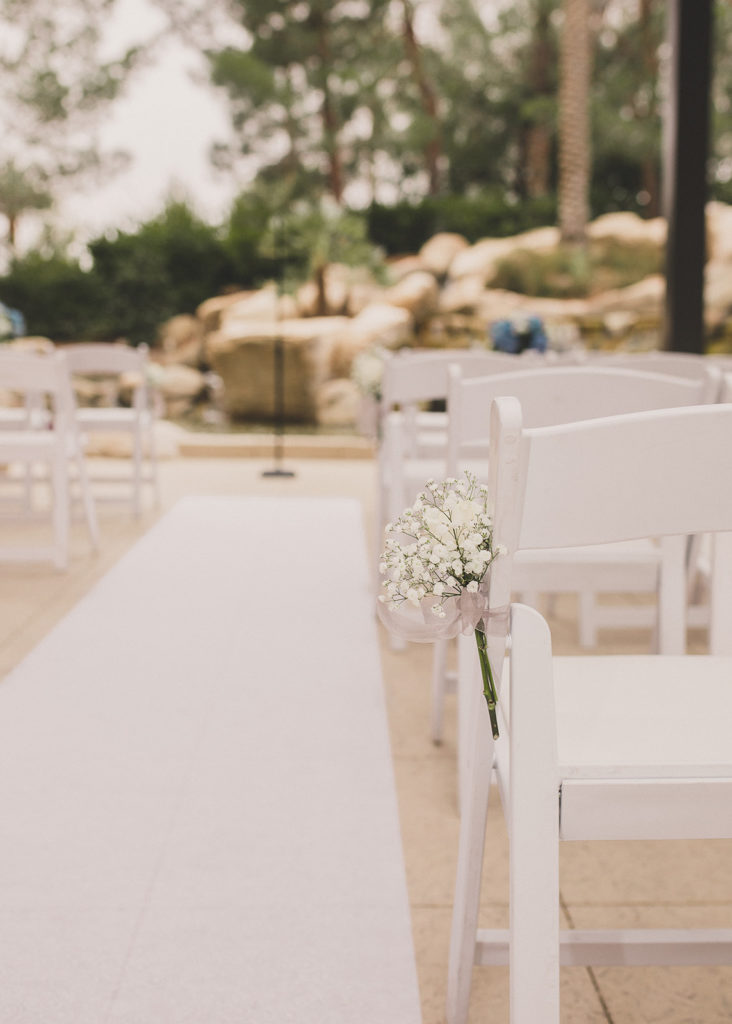 baby's breath on white chair for wedding ceremony in Las Vegas