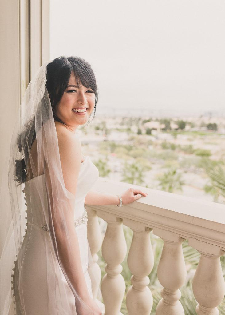 bridal portraits on balcony of JW Marriott Las Vegas