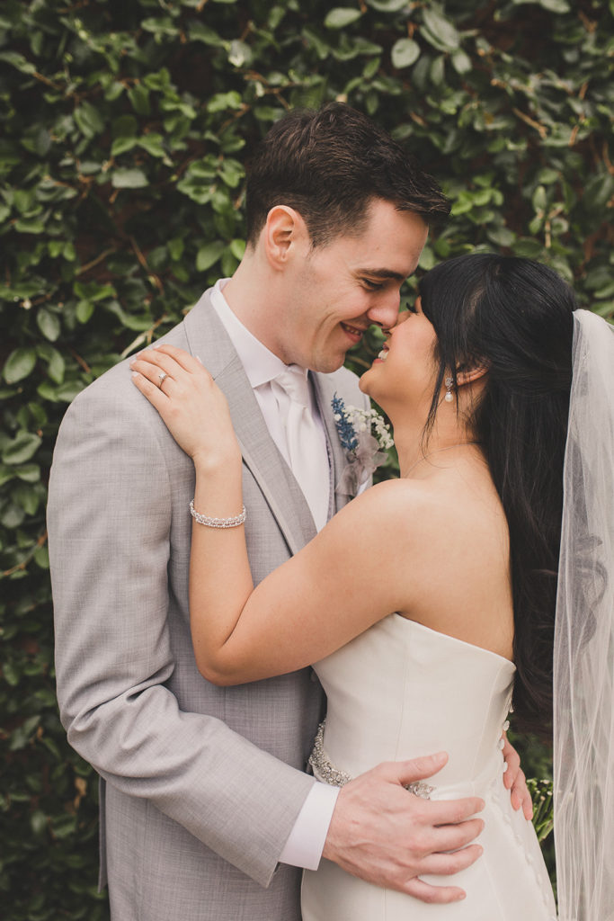 bride and groom touch noses during wedding portraits by Taylor Made Photography