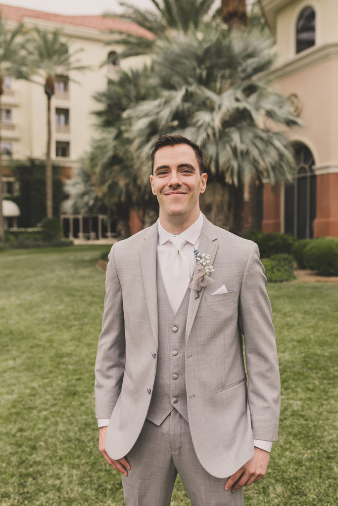 groom poses for Las Vegas wedding photos by Taylor Made Photography