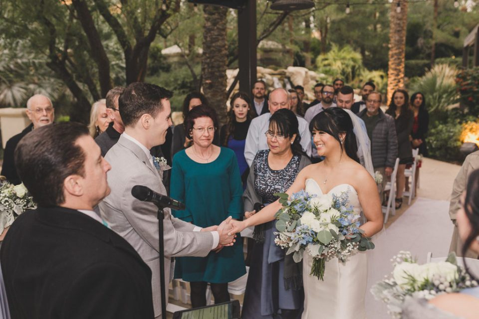 family gives bride away during JW Marriott Las Vegas wedding ceremony