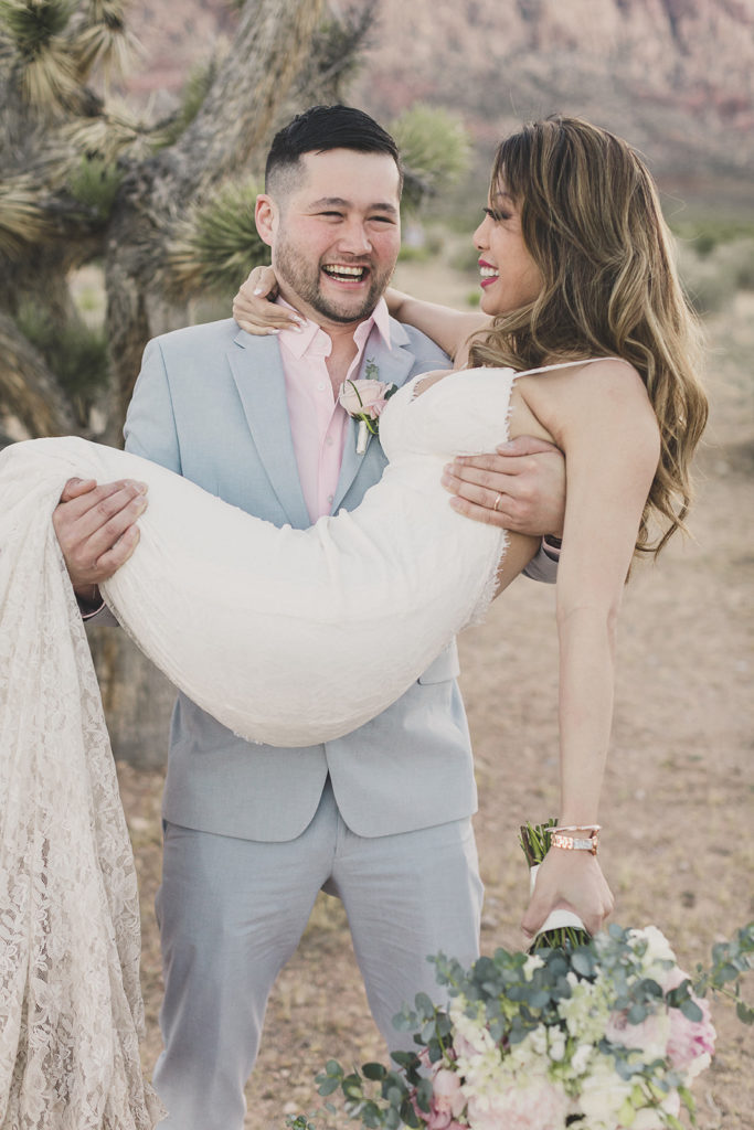 groom lifts bride for photos before eloping in Las Vegas photographed by Taylor Made Photography