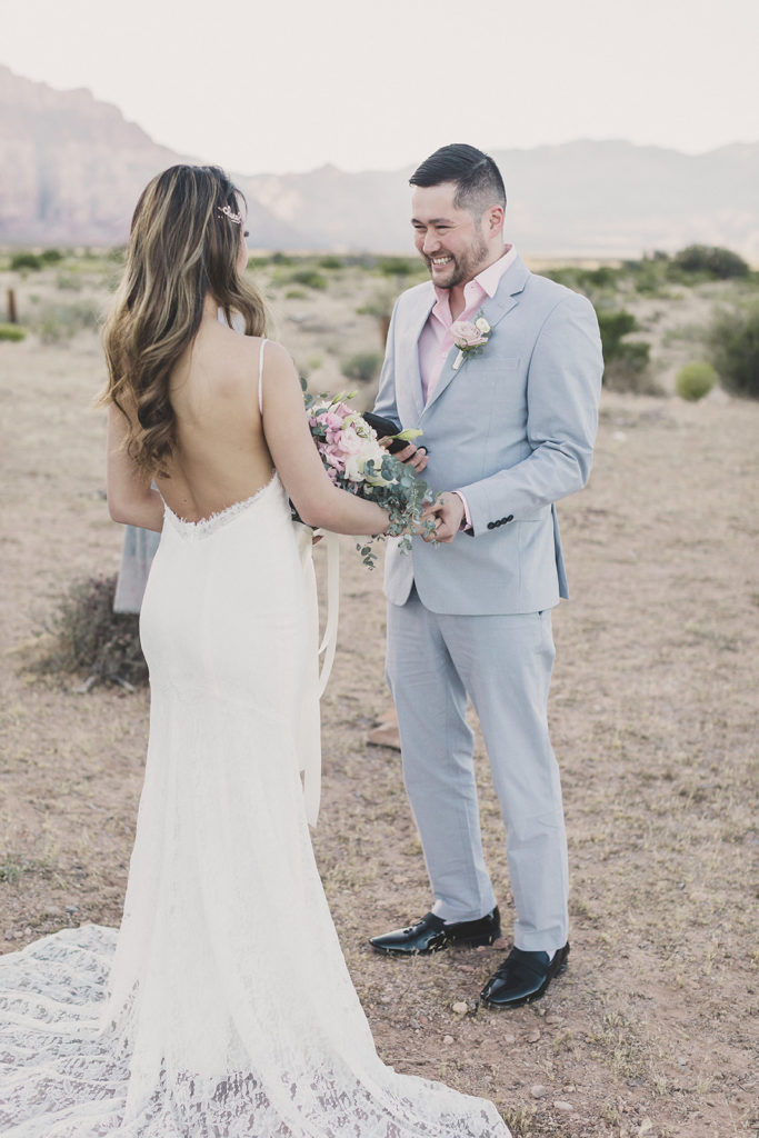 bride and groom exchange wedding vows in Red Rock Canyon