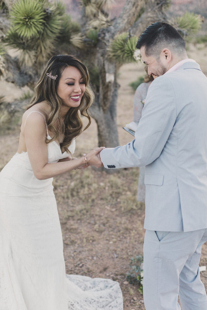 bride laughs during vows at elopement in Las Vegas