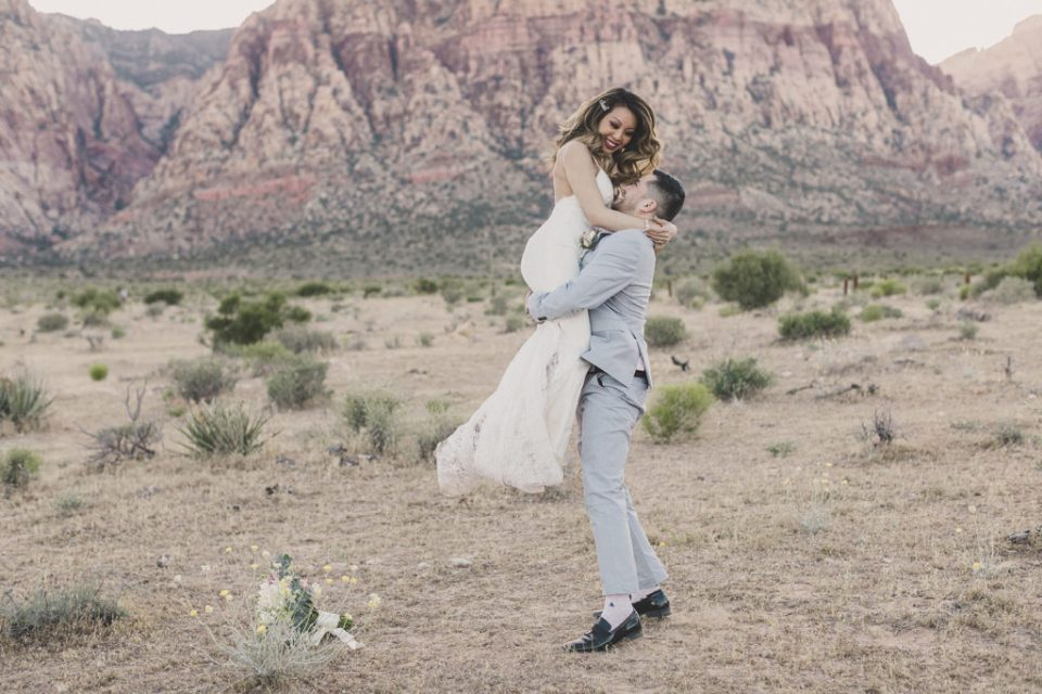 groom lifts bride up in the air during Red Rock Canyon elopement