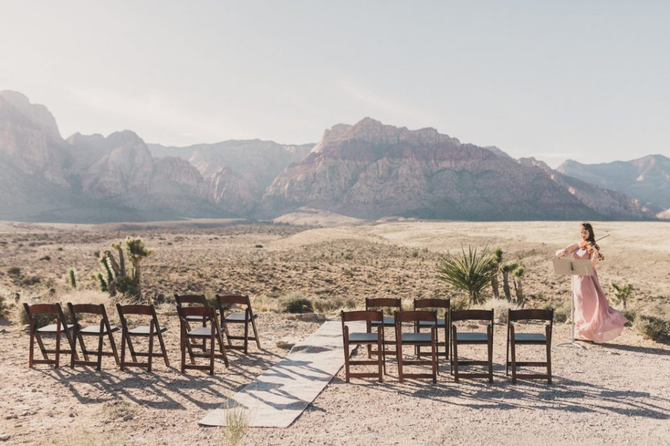 wedding ceremony in front of Red Rock Canyon photographed by Taylor Made Photography