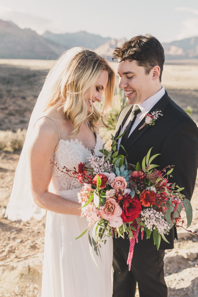 Taylor Made Photography captures bride and groom laughing in Red Rock Canyon