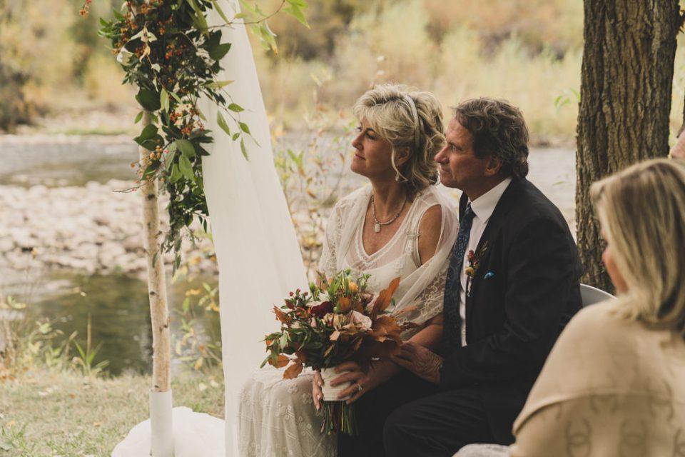 bride and groom listen to ceremony