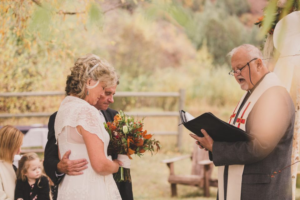 bride and groom pray during Freestone Lodge wedding