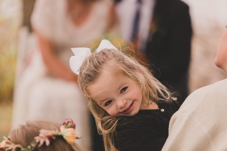 child laughs during wedding ceremony at Freestone Lodge
