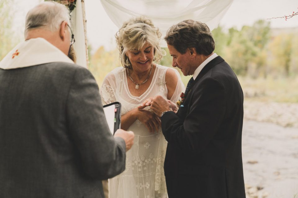 groom gives bride ring during wedding ceremony at Freestone Lodge