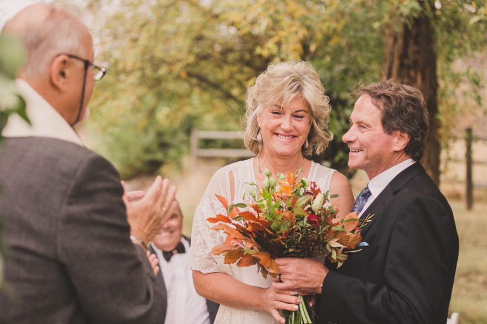 bride and groom laugh during wedding ceremony