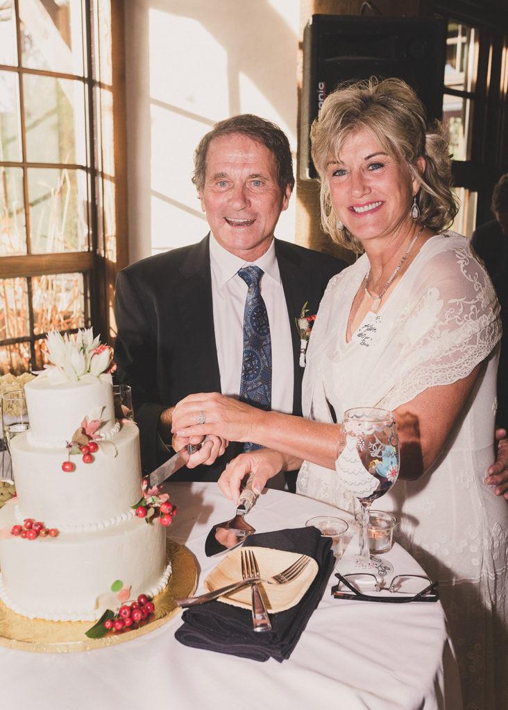 bride and groom cut wedding cake at Freestone Lodge